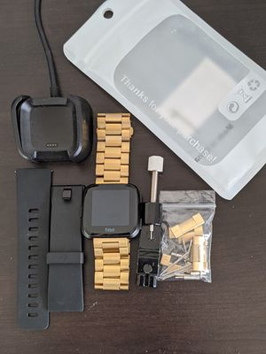 Fitbit Versa w/Gold & Black band for Sale in Jacksonville, FL