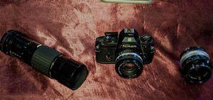 Nikon EM Vintage 35 mm SLR w/3 lenses for Sale in Buffalo, NY