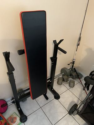 Fold away bench press with 90 lbs of weights and barbell. for Sale in Hollywood, FL
