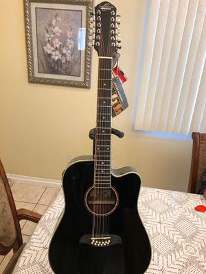 Oscar Schmidt 12 string electric acoustic guitar with built in tuner for Sale in Bell, CA