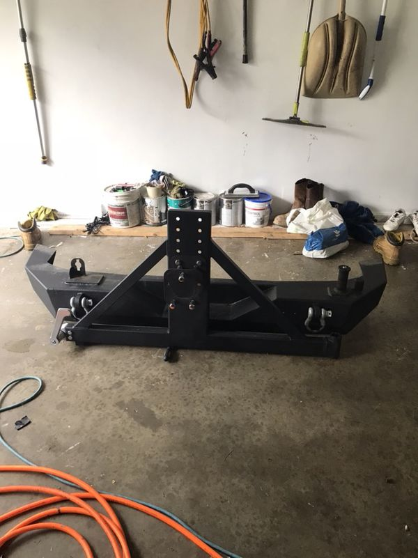 Rear bumper with tire carrier for jk