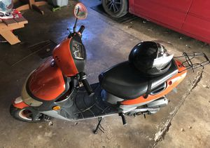 49cc moped with an adult large motorcycle helmet $650 for Sale in Elkhart Lake, WI
