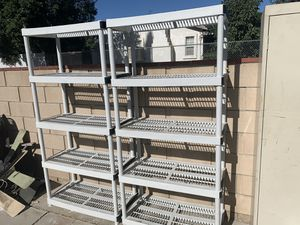 2 plastic 5 tier shelves and 1 metal cabinet with 5 tier for Sale in Fontana, CA