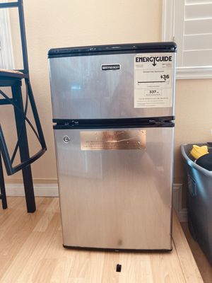 Stainless mini fridge with freezer preowned needs light cleaning for Sale in Los Angeles, CA