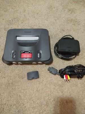 Nintendo 64 for sale comes with the expansion pak power cord & av cable only no controller for Sale in Garden Grove, CA