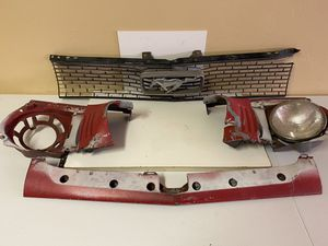 1966 Mustang front parts Grille light brackets etc and back black seat that fits 65-67 coupe for Sale in San Diego, CA