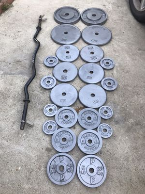 Standard Weights with Curling Bar Total weight 210lb for Sale in Fountain Valley, CA