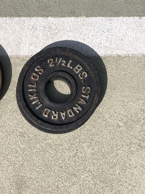 Multiple pairs of 2.5 Olympic weight plates for Sale in Tampa, FL