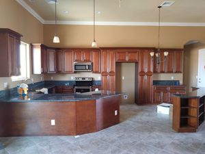 Kitchen cabinets with granite And instalación laminate floor for Sale in Las Vegas, NV