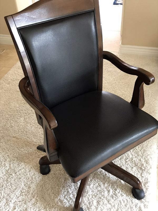 Ashley rolling leather chair with wooden frame