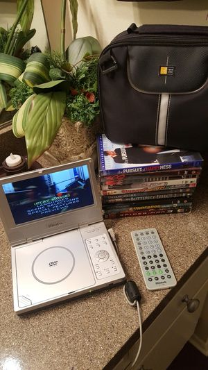 Mintek portable DVD player with 10 DVD movies for Sale in Tustin, CA