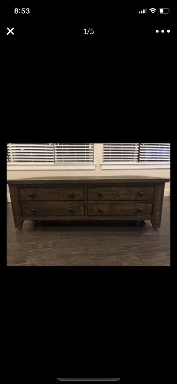 Macy's Solid Wood Sturdy Heavy Coffee Table with four drawers and on wheels that could be removed. Beautifu table that was only used for display in a