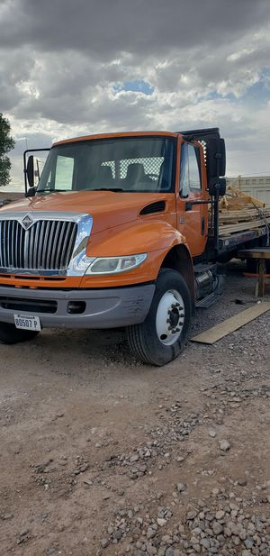 International 4400 DT Flatbed with All Terrain piggyback forklift. Motivated. for Sale in Las Vegas, NV