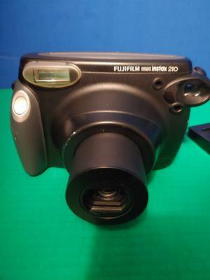 Fujifilm Instax 210 Instant Film Camera *tested* includes 8 photos in camera for Sale in Miami, FL