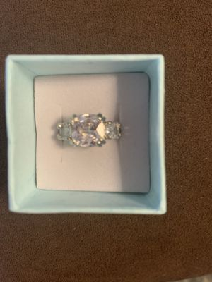 BRILLIANT CUBIC ZIRCONIA AND SILVER ENGAGEMENT/WEDDING/COCKTAIL RING!EMERALD SHAPED CENTER STONE, ROUND STONES ON EACH SIDE! for Sale in Estero, FL