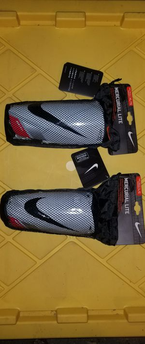 Brand New Nike Mercurial Lite Soccer Shin Guards Slip In Ultra Light Adult Sizes Large, XL for Sale in West Covina, CA