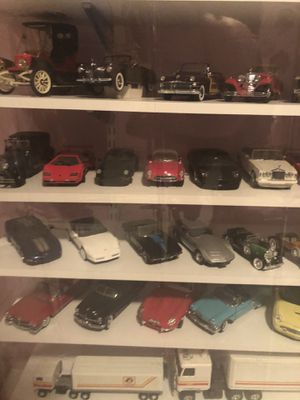 Porcelain dolls over 125 , old school car collection & glass collection for Sale in Orlando, FL