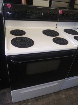 Frigidaire black and beige 4 burner coil electric stove for Sale in Cleveland, OH