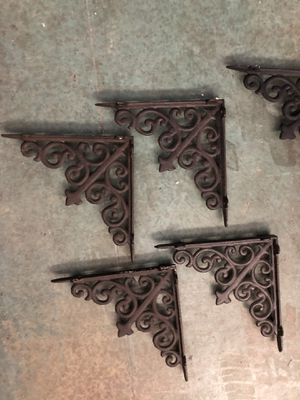 Shelf brackets. Four dark brown and two black. Wrought iron very solid for Sale in Lancaster, CA