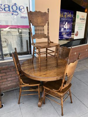 Oak table and four chairs kitchen or dining with extension leaf for Sale in San Diego, CA