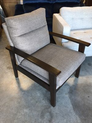 Floor model Lifestyle Wood and Grey Fabric chair for Sale in Willow Spring, NC