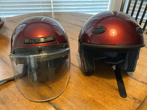 2 matching motorcycle helmets (1 with visor- L) ( 1-M) for Sale in Winder, GA