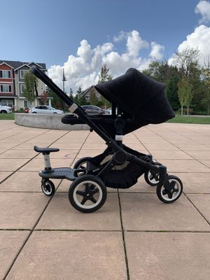 Buffalo bugaboo stroller with bassinet, car seat and second child attachment! for Sale in Everett, WA