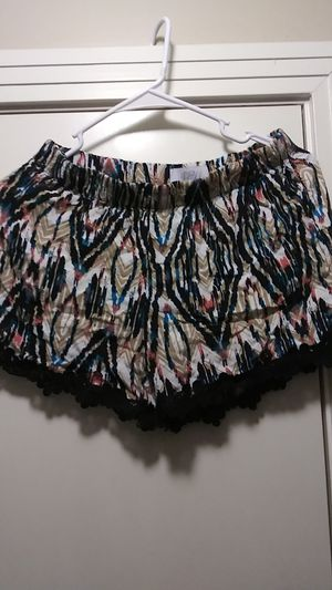 Genius size large dressy shorts with fringe at the very bottom barely worn size large for Sale in Sugar Creek, MO