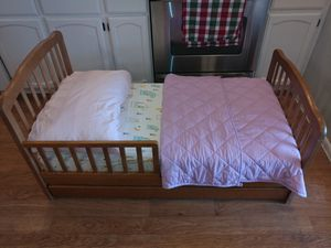 Wood toddler bed with mattress for Sale in Chandler, AZ