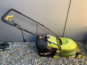 Sun Joe Electric Lawn Mower with grass bag for Sale in Seattle, WA