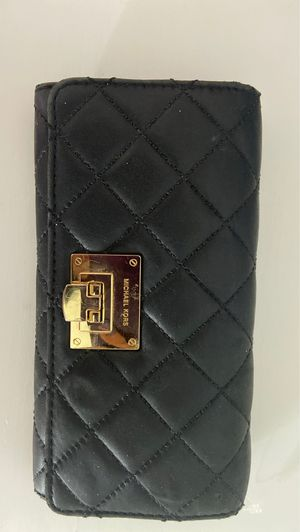 Michael Kors Black leather quilted wallet. Never used for Sale in Twinsburg, OH