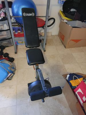 Bench press with bar weights and dumbbells for Sale in Las Vegas, NV