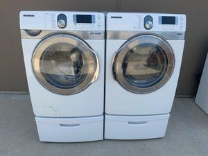 SAMSUNG FRONT LOAD WASHER AND ELECTRIC DRYER SET WITH STEAM for Sale in Grand Prairie, TX