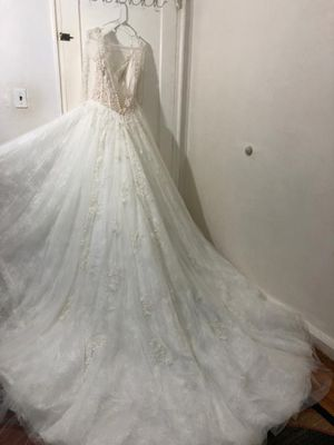 Wedding dress with beautiful detail lace and long sleeved for Sale in Atwater, CA