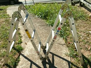 Versa Industrial Rated, multi-purpose 12' ladder / 6'step ladder / scaffolding / dual ladder / ideal for stairs and all those hard to reach places! for Sale in Winchester, KY