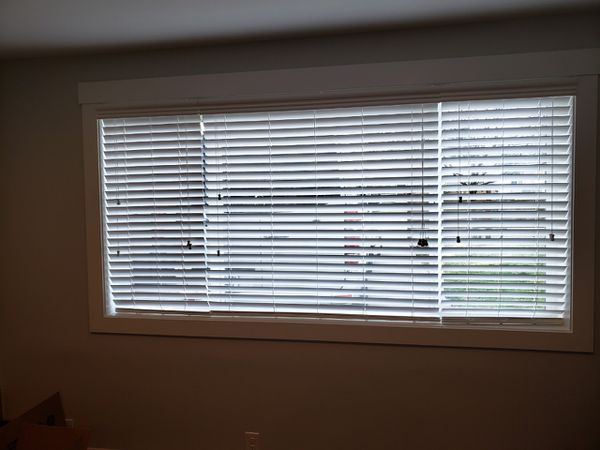 Brand new faux wood blinds