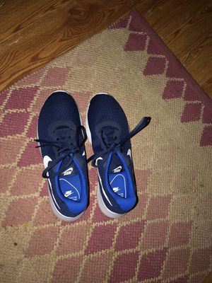 Men's blue and white nike shoes size 9.5 for Sale in Lynchburg, VA