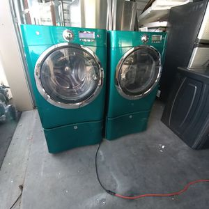 ELECTROLUX FRONT LOAD STEAM WASHER AND DRYER SET WITH PEDESTALS for Sale in Golden, CO