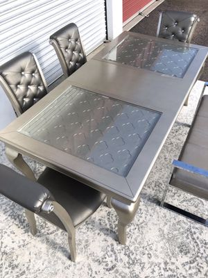 Champagne silver Extendable dining table set with 4 chairs for Sale in San Diego, CA
