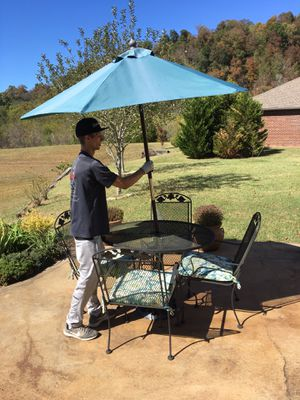 Table,4 chair,cushions and umbrella with base for Sale in Brentwood, TN