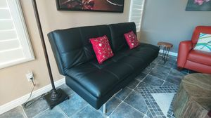 Beautiful black leather sofa futon for Sale in Carlsbad, CA