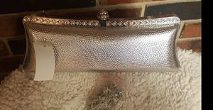 Hardshell silver clutch reduced@! for Sale in Clear Lake, IA
