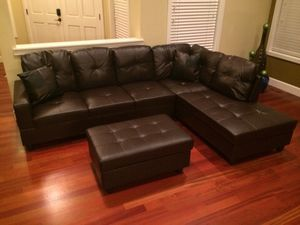 Brown leather sectional couch and ottoman for Sale in Everett, WA