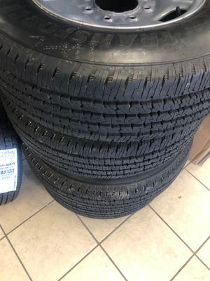 New truck Tires - Rim and Tire Chevy - Chevy Rim and Tire - 234/75/17 Firestone on 8 lug chevy rims - came off of new Chevy 2500 for Sale in Plant City, FL