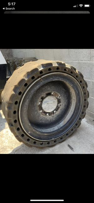 Flat free skid steer wheels and tires for Sale in Glendale, AZ