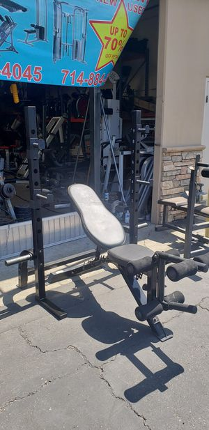 Squat rack/bench press with bench, bar and weights for Sale in Anaheim, CA
