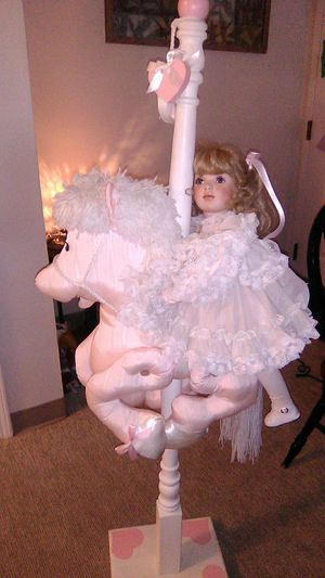 Studio 7 concepts porcelain doll on a carousel horse for Sale in Marlborough, MA