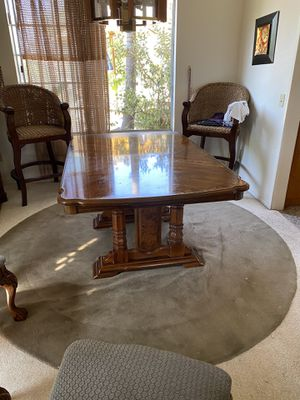 Dining table with a leaf, solid wood, it comes with original pads. for Sale in Riverside, CA