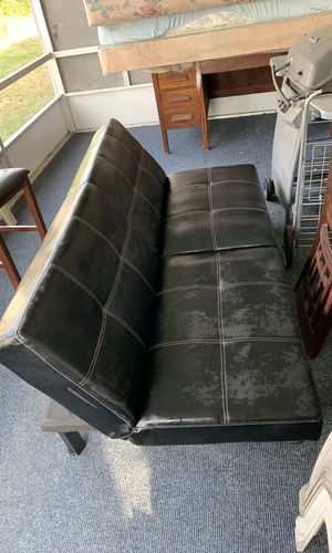 Sofa futon black leather for Sale in Orlando, FL