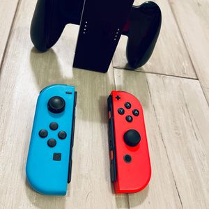Nintendo Switch Red And Blue Joycons with Joycon Holder for Sale in Ashburn, VA